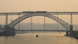 Porto's Eiffel bridge surrounded by smoke from wildfires